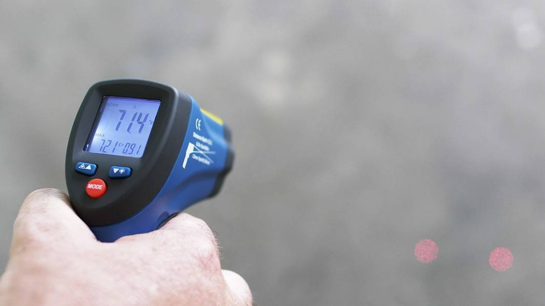 IRT2 Infrared Thermometer (in use) with hand (ºF)